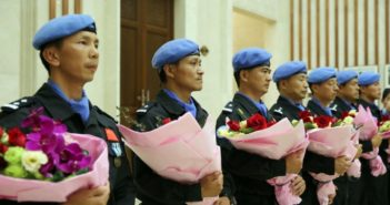 chinese peacekeepers holding flowers at coming home ceremony