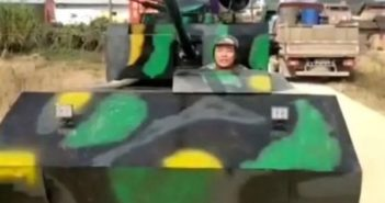 man driving self-made tank in china