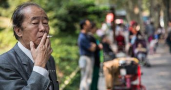 man smoking in park in shanghai