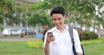 young man using phone outside