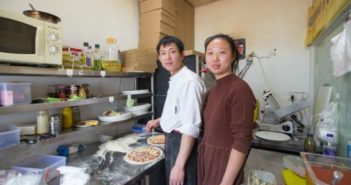 couple in restaurant kitchen in china