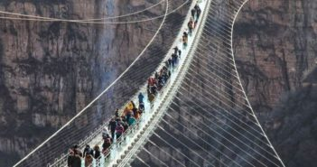 tourists on glass bridge in china