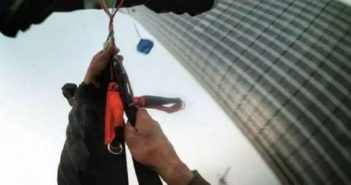 image from persona camera attached to head of parachutist in mid air