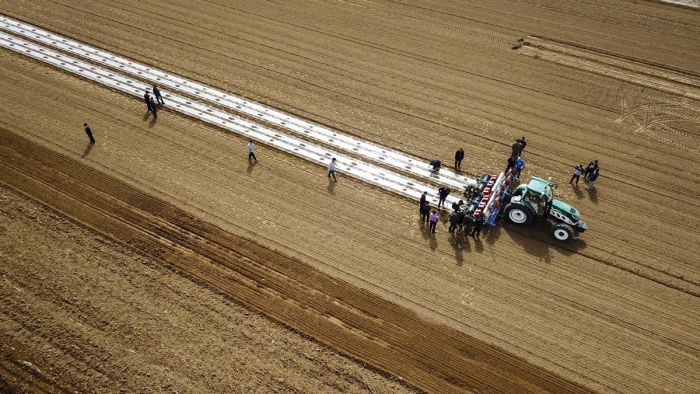 top view of a self-driving tractor working on field in xinjiang