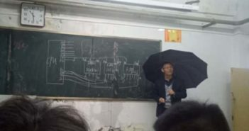 teacher holding umbrella during class in china