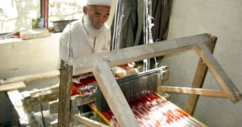 man making atlas silk