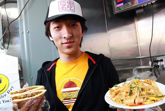 man holding chinese snacks