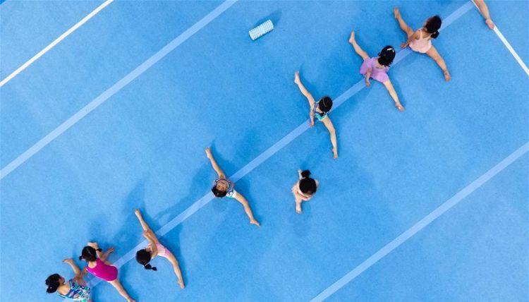 top view of children practicing gymnastics