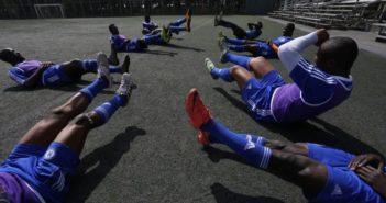 black football players training