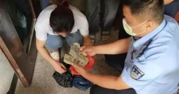 police officer and woman with wads of cash