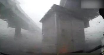 makeshift house blowing across the road during storm in chengdu
