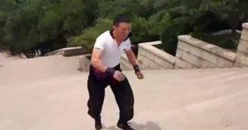 man running down stairs backwards