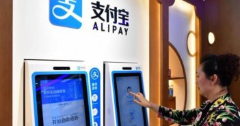 side view of woman using alipay at pharmacy in china