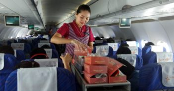 air hostess serving people