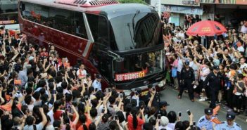 bus with students surrounded by parents in china