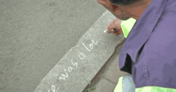 man using chalk to write on the street in china