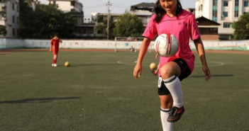 girl playing football in china