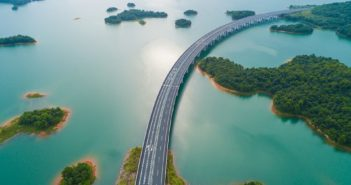 arial view of motorway across a water reservoir in china