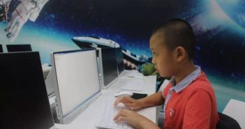 young boy on the computer in china
