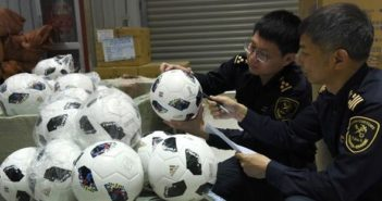 chinese customs officers inspecting fake world cup footballs