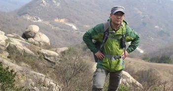 man hiking in mountains in china
