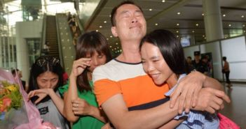 girl being reunited with her family in china
