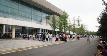 people queuing outside library in tianjin on summer day