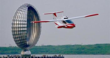 front view of light aircraft flying over lake in shanghai