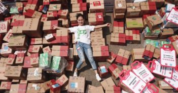 girl laying on top of packages