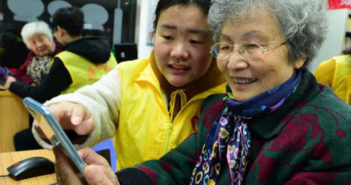 old lady being given a demo at a phone store in china