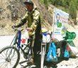 man cycling along mountain road in china