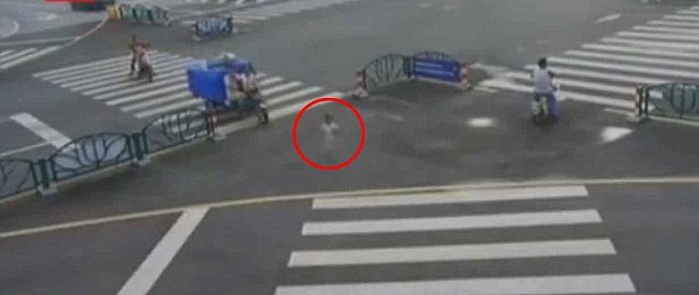child circled in red wandering the street in china