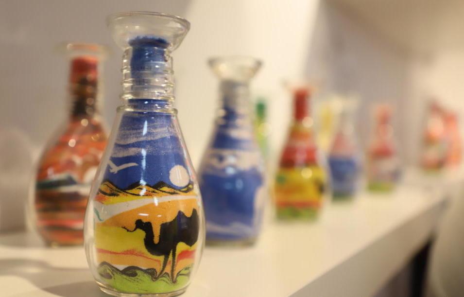 sand bottle art on shelf