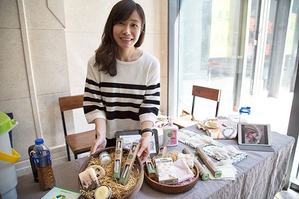 woman posing for picture with food