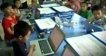 children attending computer coding class in china