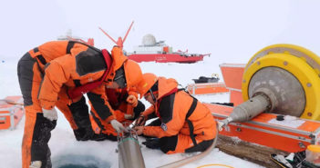 chinese scientists working on equipment in arctic