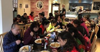 chinese tourists at fish and chip shop in yorkshire