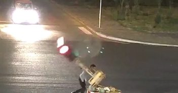 driver breaking traffic light at intersection in china