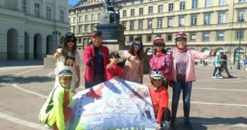 group photo of chinese cyclists in europe