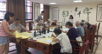 young and old people practicing chinese characters at nursing home in china