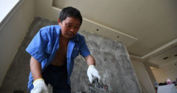 man working with cement at home in china