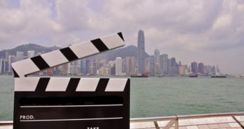 movie set board in front of city skyline in china