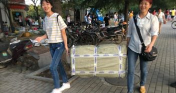 mother and daughter carrying luggage delivered by courier in china