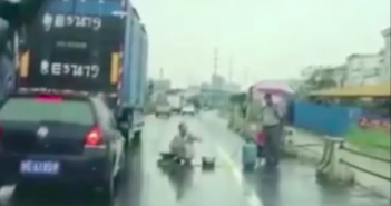 man cooking in middle of the road in china