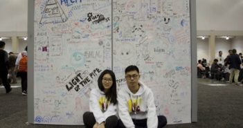 couple sitting on floor in front of white board at university in shanghai