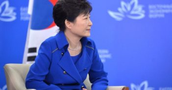 Park Geun-hye sitting in a chair at a conference