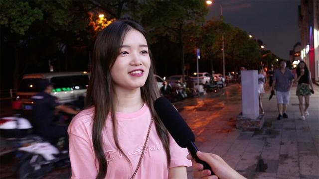 girl being interviewed on the street in china