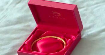 golden bracelet in a red box