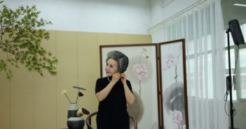 elderly woman getting ready for photoshoot