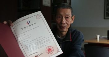 old man holding patent certificate in china